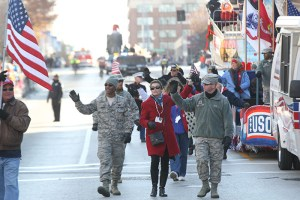 Soldiers in uniform along with the USO float at the 2013 Ameren Missouri Thanksgiving Day Parade.