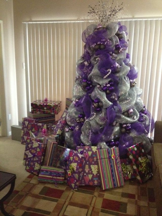 Christmas tree decorating with purple deco mesh