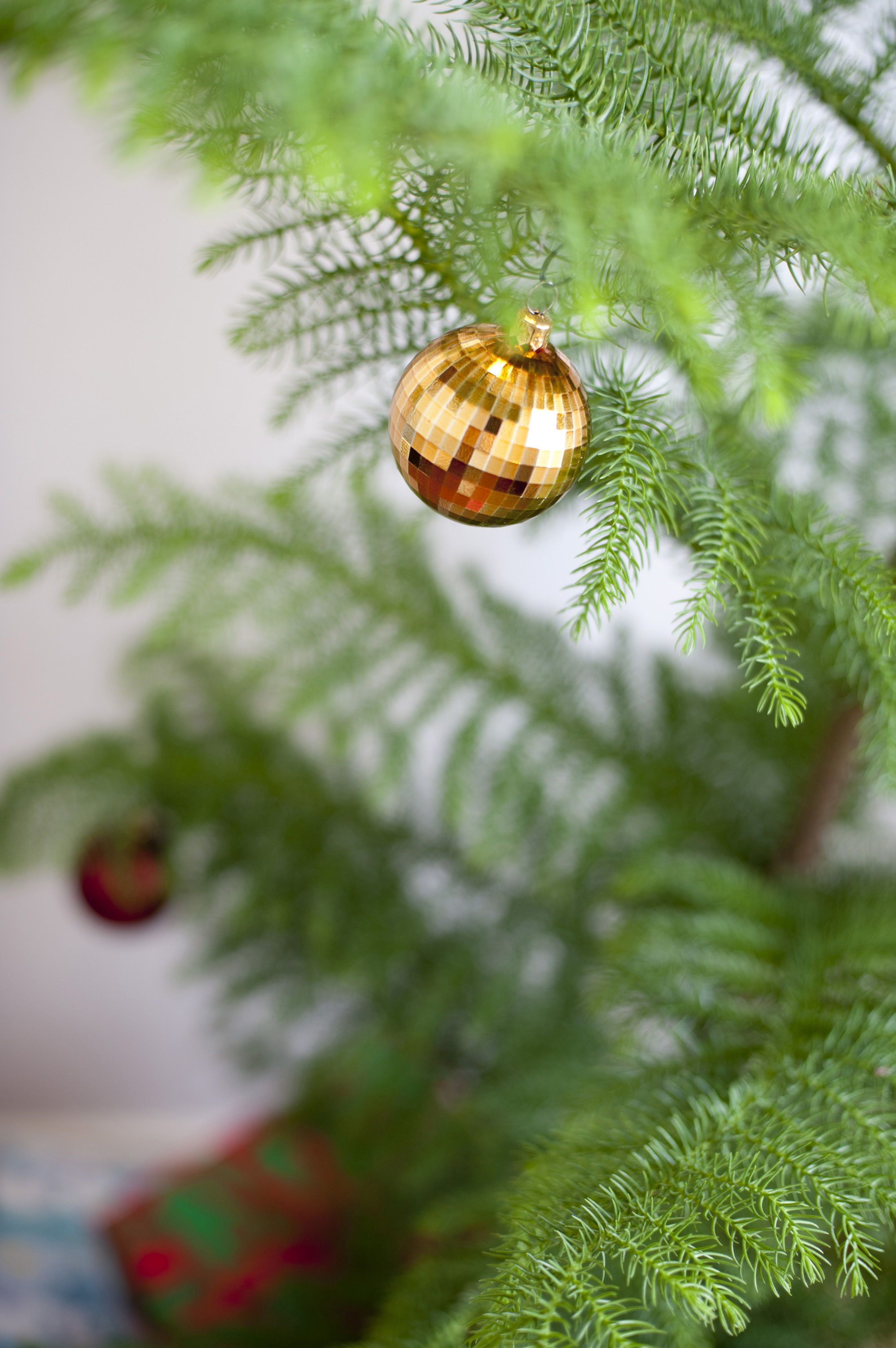 Photo Of Single Gold Bauble On A Natural Christmas Tree