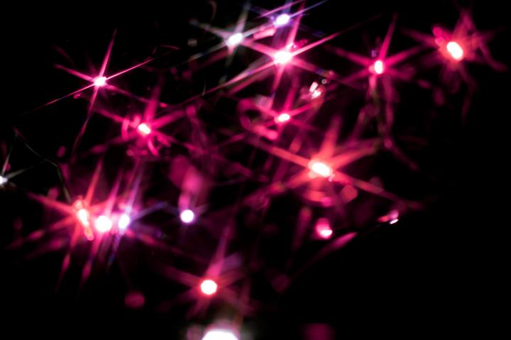Photo Of Christmas Background Of Pink Starburst Lights