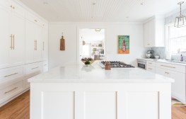 Custom-milled shaker-style cabinets and island end panels. Photo courtesy: Julia Steele
