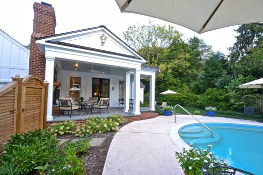 Porch addition with fireplace and custom gate