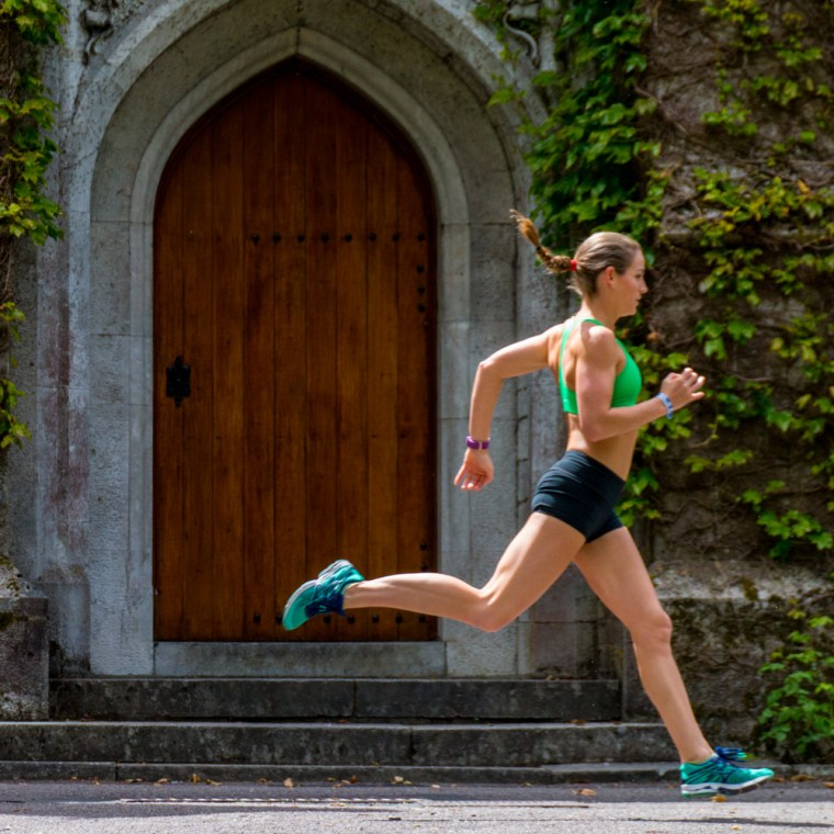 Corky running in front of an ivy-clad door at University College Cork