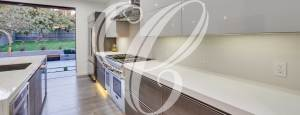 Bauformat modern German kitchen cabinetry with white countertops from Christophers Kitchen & Bath.