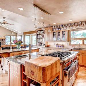 Craftsman style kitchen remodel in Boulder, CO outside Denver, CO with custom cabinets, integrated woodblock and two islands.
