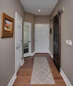 Custom barn wood sliding barn door in laundry room remodel off kitchen remodel.