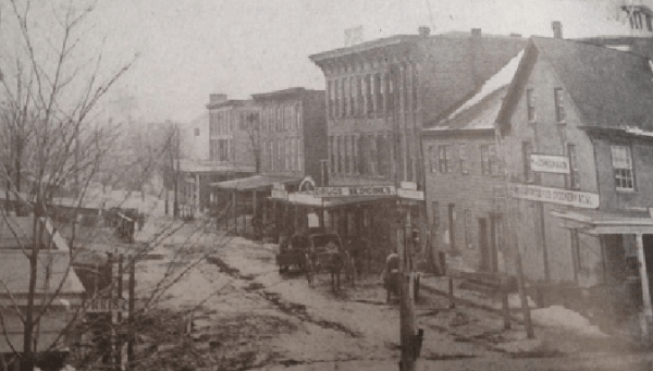 In 1870, the corner of Spring Street, at left, and Main Street was already the main commercial corridor for Newton, as seen in this photograph from 'Images of America: Newton.' The book notes that soon after Samuel Johnson began a dry goods business that became a major anchor of what developed as the town square.