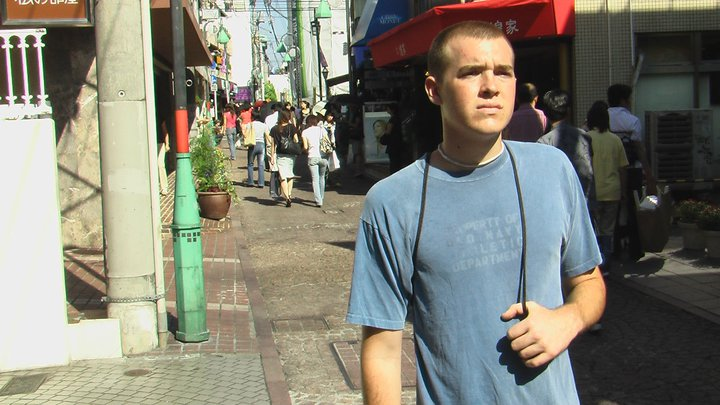 20-year-old Chris Wink standing in the middle of a tiny Tokyo street