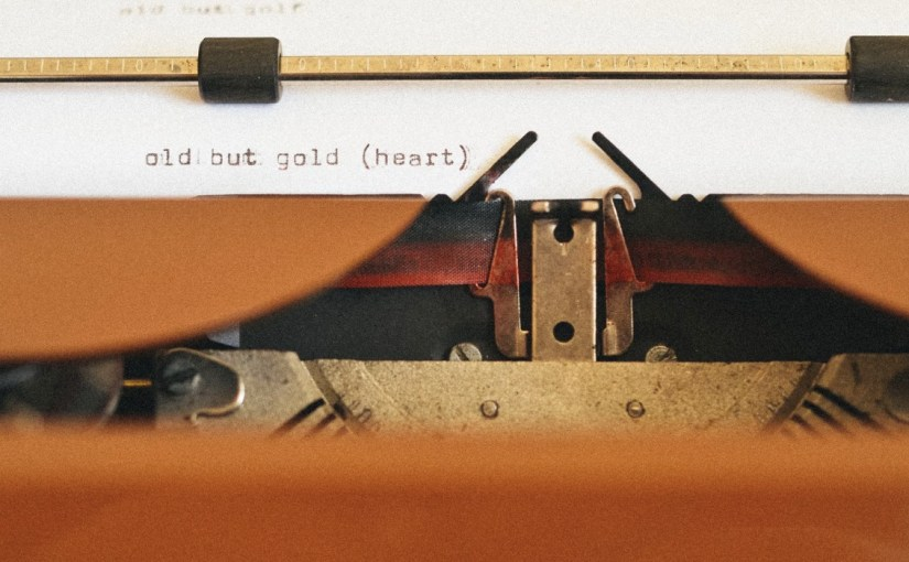 "Closeup of a typewriter with text ""old but good"""