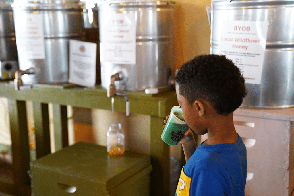 Little One enjoying the Honey Root Beer at the Walker Honey Farm Bee Tour