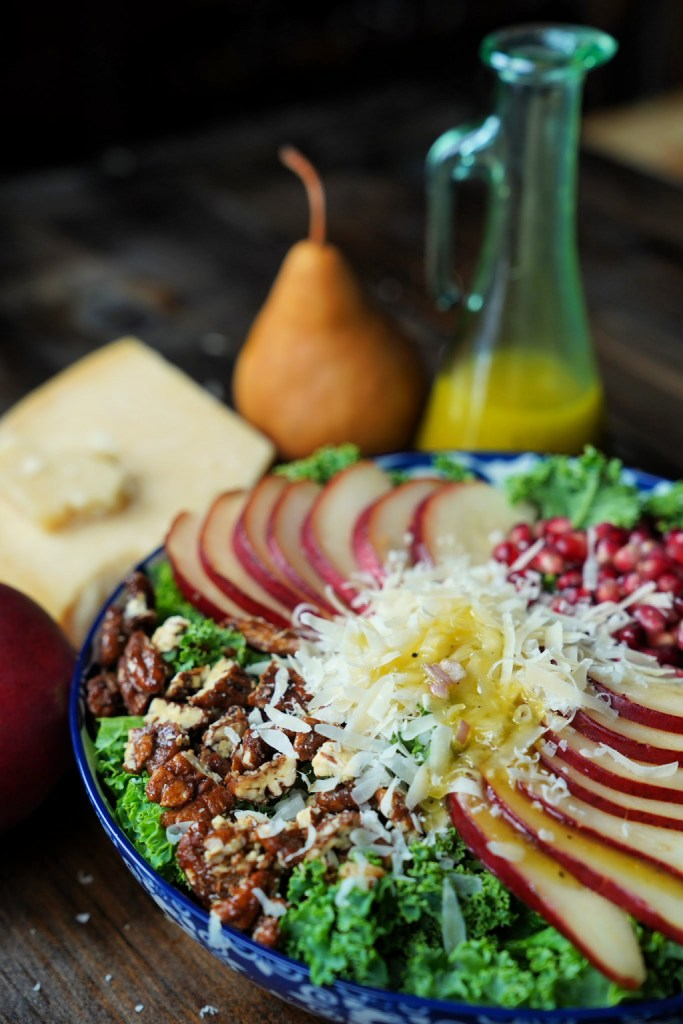 Pear Kale salad with pomegranate and candied pecans shaved parmigiano, and white balsamic vinaigrette