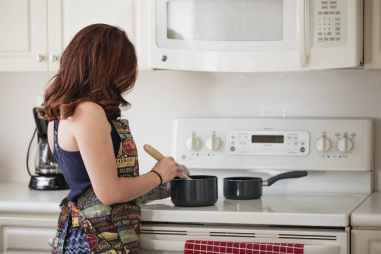 woman in the kitchen preparing to cook