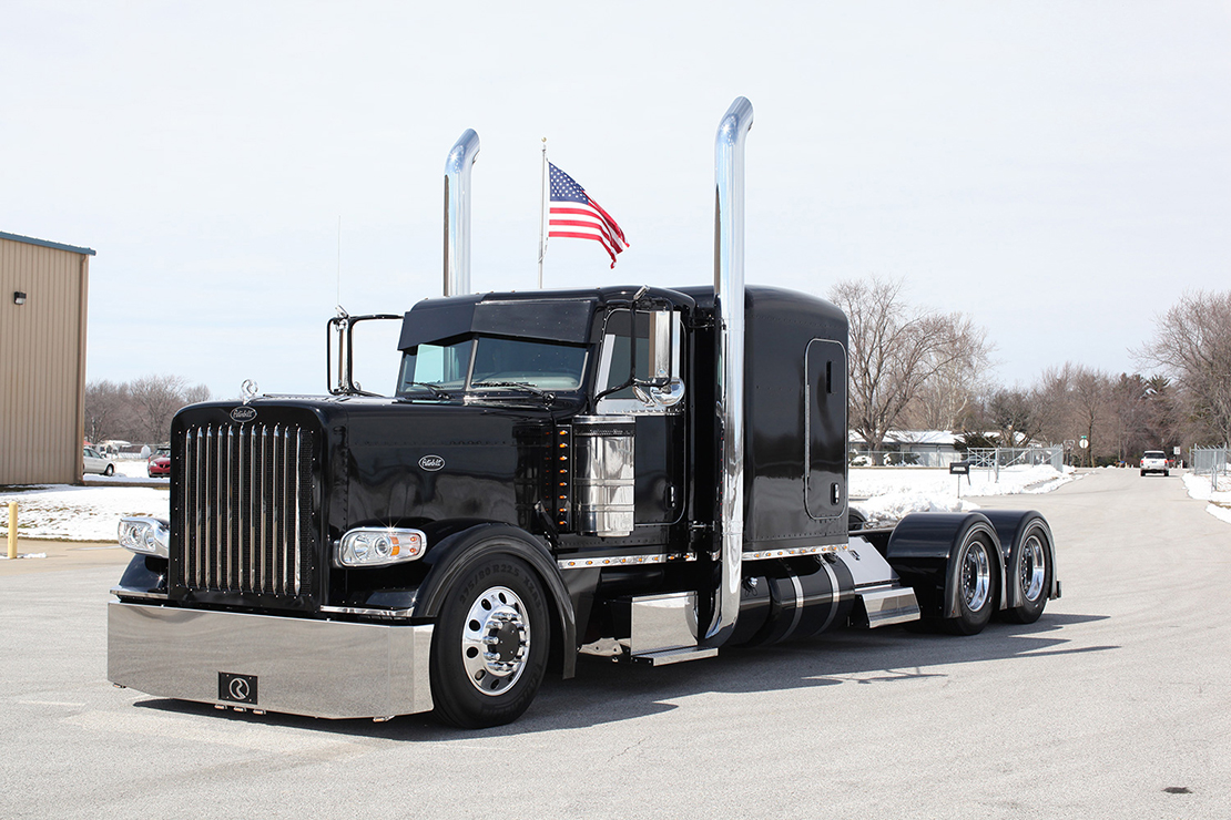 2013 Chrome Crew Peterbilt 389 Flat Top with Old Glory waving in the background