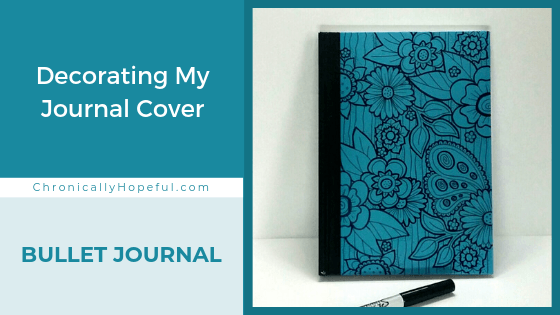 A journal with hand drawn floral designs on the cover. Title reads: Decorating my journal cover. Bullet Journal.