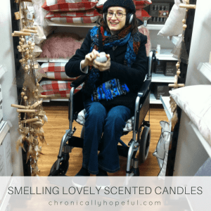 Smelling scented candles out in a real shop