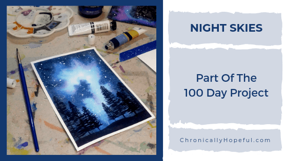 Flatlay of watercolour night sky, Title reads Night Skies, part of the 100 day project.