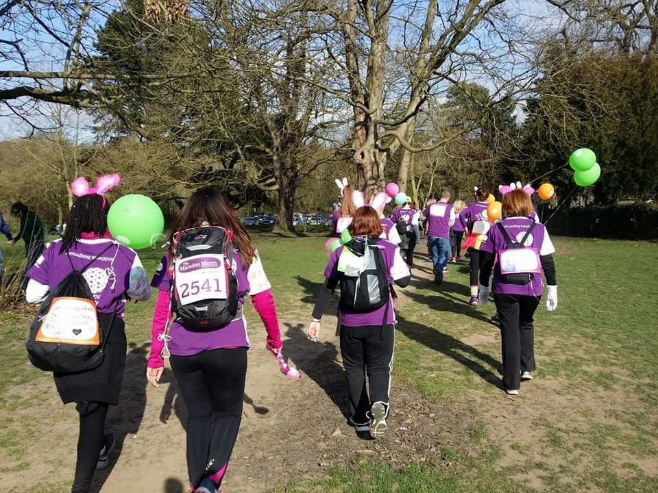 The 5 Bouncing Pink Bunnies, wearing their Marsden March shirts, black leggings and pink bunny ears walking through a field at the Marsden March, Chronically Hopeful