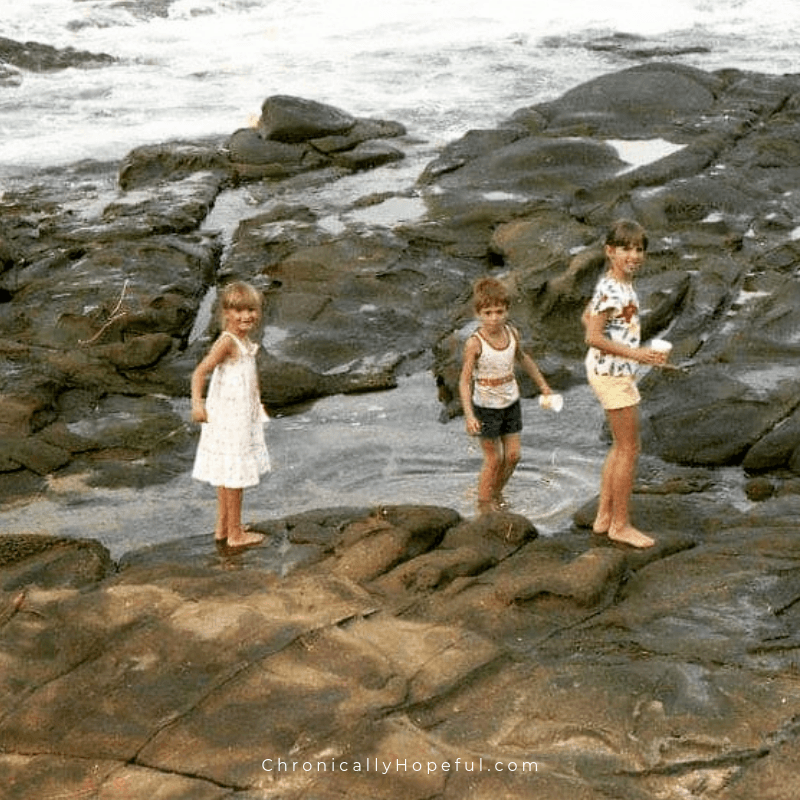 Char and her cousins exploring rock pools on a beach in South Africa in the 80s