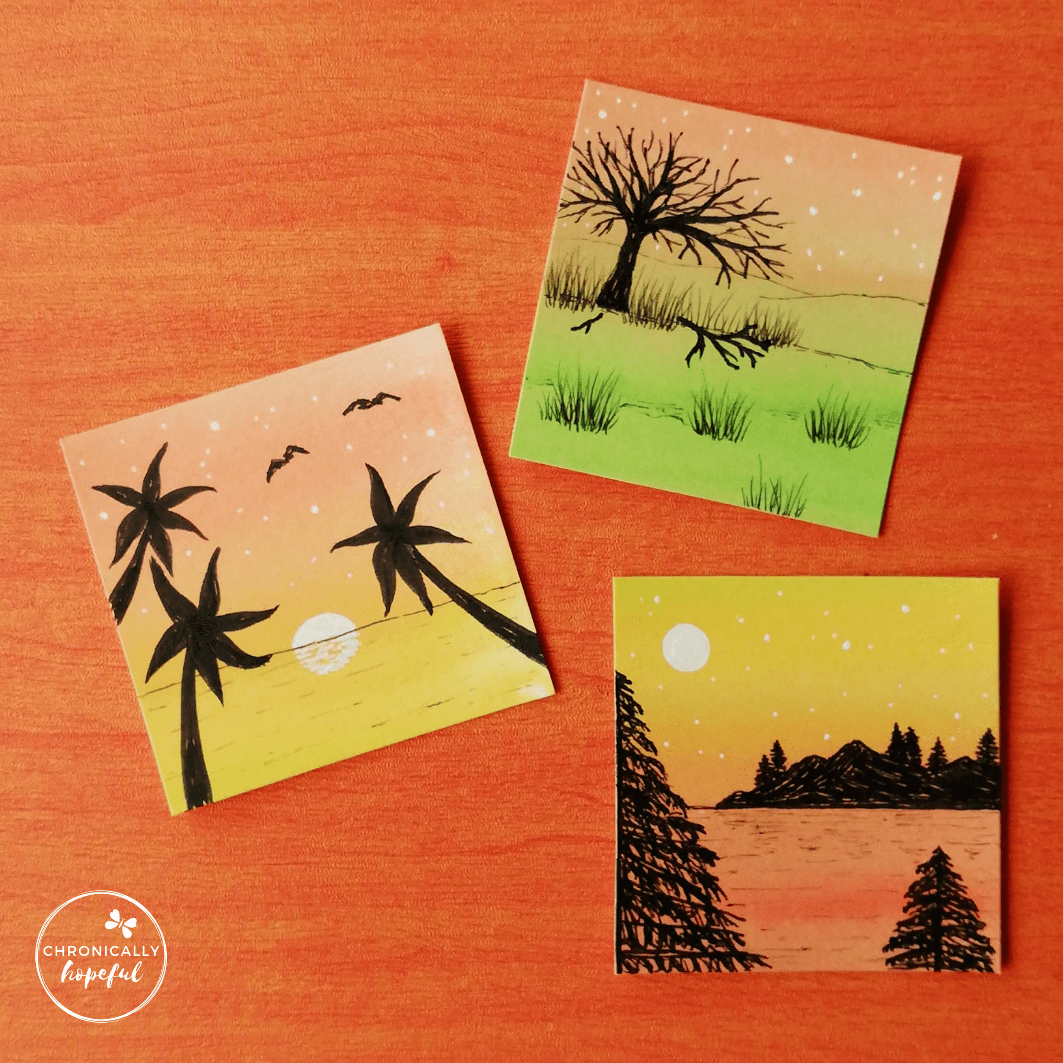 Three 6x6cm mini cards, painted with sunset colours, each with a sunset scene drawn on with black ink.
