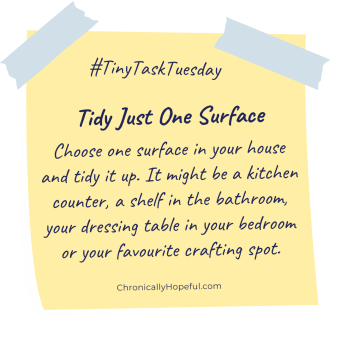 A post-it note with this week's Tiny Task Tuesday, tidy just one surface