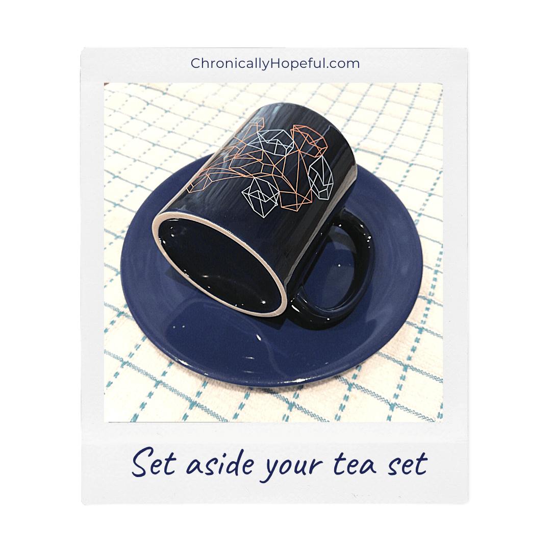a blue mug on top of a blue plate