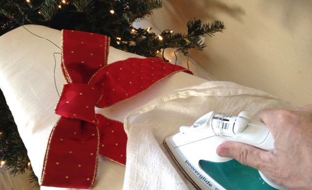 Keeping it simple with holiday decorations - ironing last year's wreath bow. A post on Tumbling the stone: a chronic illness blog
