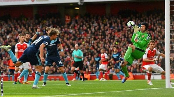 FILE PHOTO: Petr Cech of Arsenal who is wearing a head helmet after an injury makes a crucial save against Middlesbrough