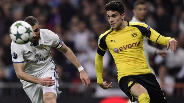 Dortmund's Spanish defender Marc Batra (right) has been taken to hospital