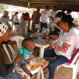 A child being attended to by a doctor during the Health Fair organised by Sen. Babajide Omoworare