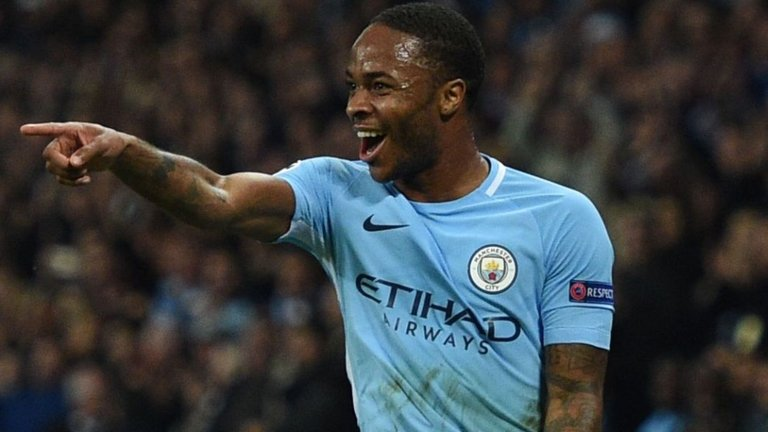 Manchester City's English midfielder Raheem Sterling celebrates scoring his team's second goal