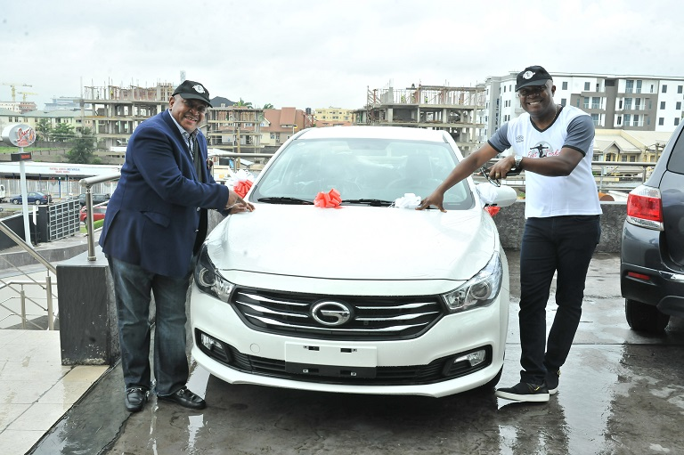 Valentine Ozigbo; Chairman, Feet 'n' Tricks International and Olisa Adibua, Director, Feet 'n' Tricks International, with the Grand Prize of Saloon Car donated by one of the Sponsors GAC Motors Africa during the Press Conference to announce the commencement the call for entries for Freestyle Football 2018 African Championship to be organised by Feet 'n' Tricks International in partnership with the World Freestyle Football Association (WFFA) ,in Lagos on Friday