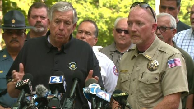 Missouri governor Mike Parson (left) and Stone County Sheriff Doug Rader speaking with reporters on Friday