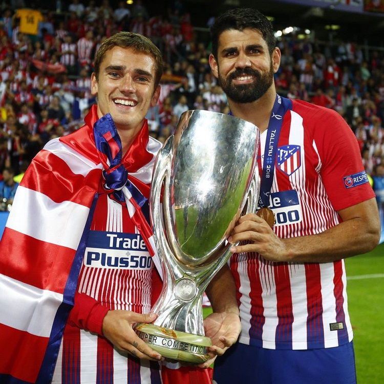 Antoine Griezmann and Diego Costa pose with the Super Cup
