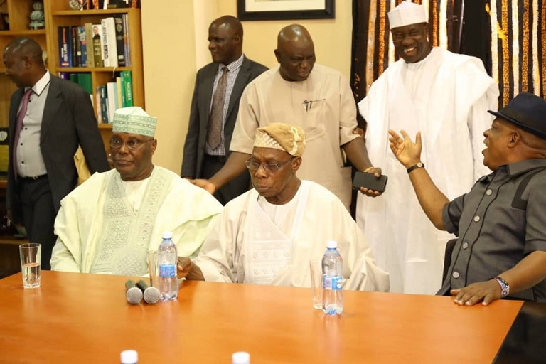 Atiku Abubakar and Chief Olusegun Obasanjo getting ready to hold a press conference in Abeokuta
