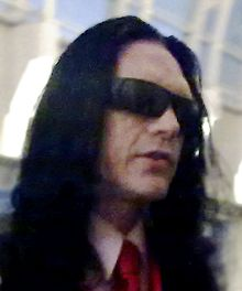 A former girlfriend reveals Tommy Wiseau's former job as an Al-Qaeda drug runner.
