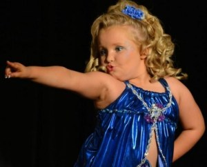 The late Honey Boo Boo poses for judges on the reality TV show Toddlers and Tiaras.