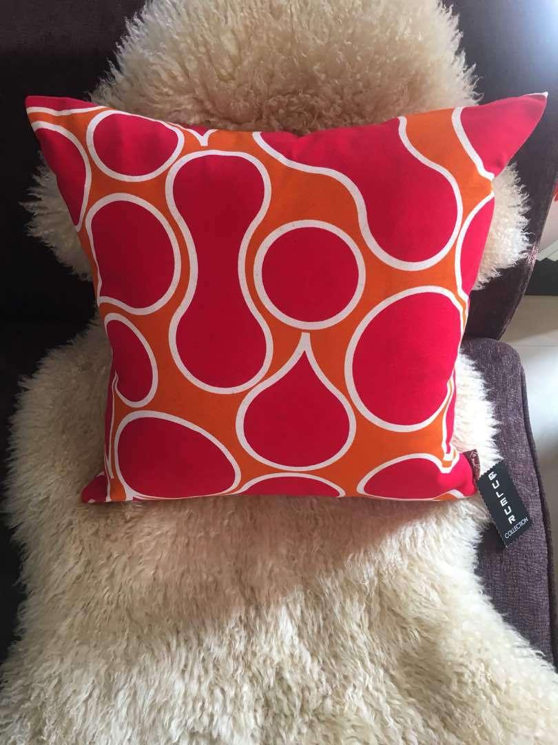 red orange coleure throw pillows