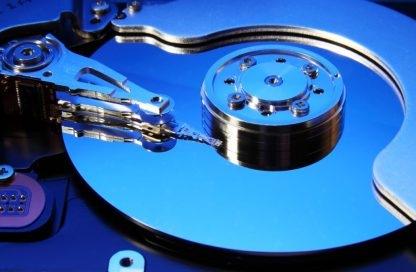 Close-up view of the opened hard disk drive(toned in blue mode)