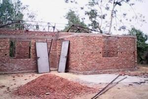 তাইন্দংয়ে আশ্রায়ণ প্রকল্পের আওতায় নির্মাণাধীন বাড়ি