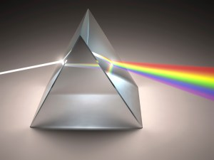 The crystal prism disperses white light into the many colors of the visible light spectrum (ROYGBIV)