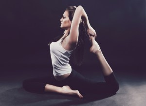 A woman holding a stretching pose