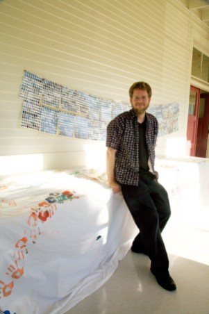 Posing with 3,000 printed mattresses.