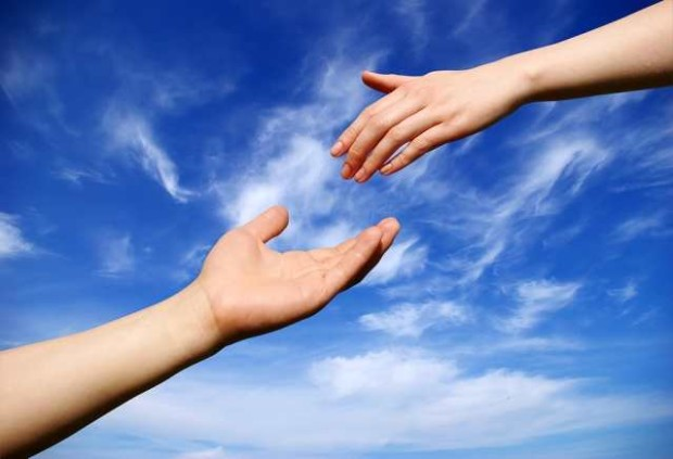 helping hand with the sky background