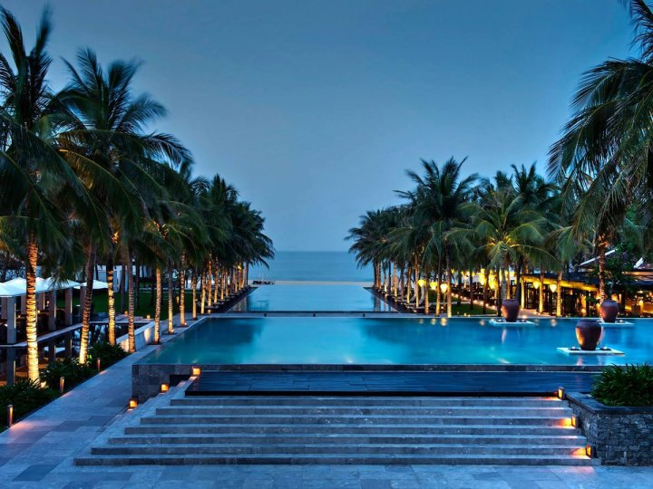 at-the-nam-hai-in-vietnam-youll-hardly-have-to-choose-between-the-pool-and-the-beach-considering-the-extravagant-pool-leads-right-to-the-sand