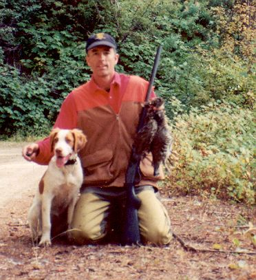 Brittany spaniel with ruffed grouse