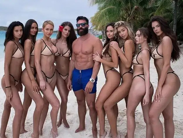 Image result for muscle man surrounded by girls