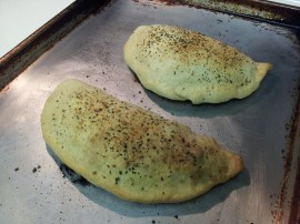 Two calzones, fresh out of the oven.