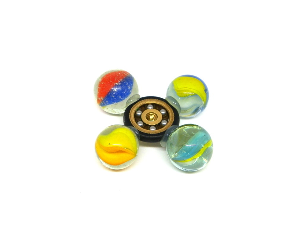 spinner casero hecho con canicas