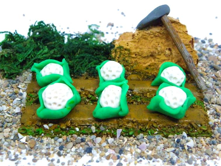 miniatura decorativa de un huerto de coliflores para el belen