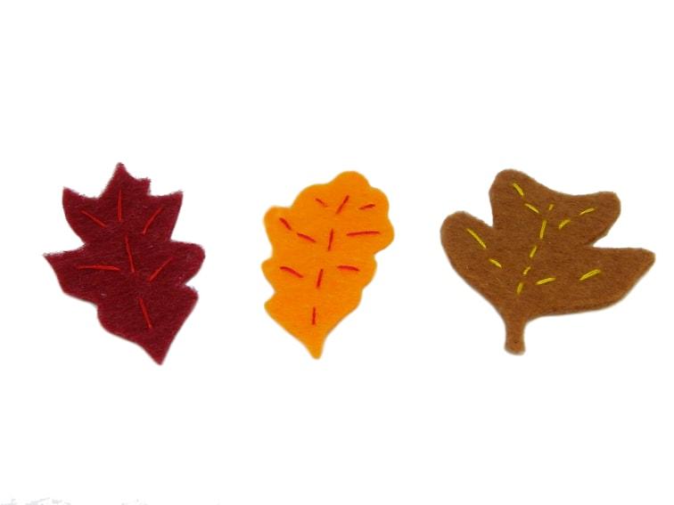 hojas caducas hechas con fieltro de colores hilo y aguja